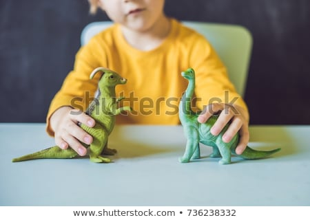 Garçon dinosaures bâtiment art sable Photo stock © galitskaya