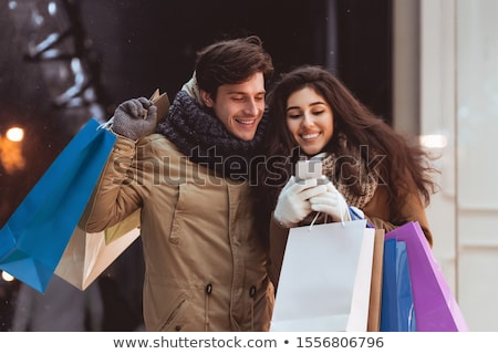 Family of shopaholics searching for seasonal discounts in online shops Stock photo © pressmaster