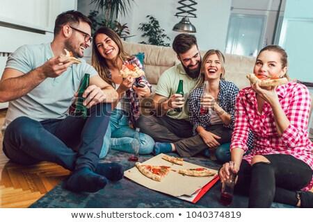 Mutlu arkadaşlar içecekler pizza parti ev Stok fotoğraf © dolgachov