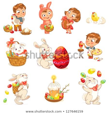 cartoon Easter bunny with large colored egg Stock photo © izakowski