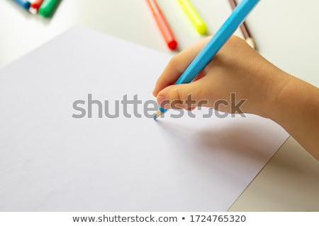 hand holding crayon pen color Stock photo © yupiramos