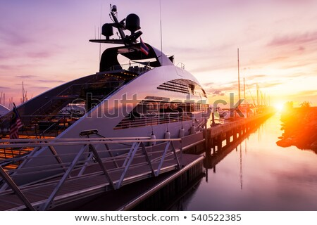 Yachts and boats in the harbor on Mediterranean sea coast at sunset, travel and leisure Stock photo © Anneleven