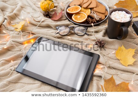 tablet pc, glasses, autumn leaves and garland Stock photo © dolgachov