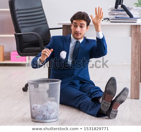 Young handsome businessman employee working in office in paperwo Stock photo © Elnur