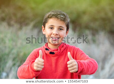 Happy guy with red jersey saying Ok Stock photo © Gelpi