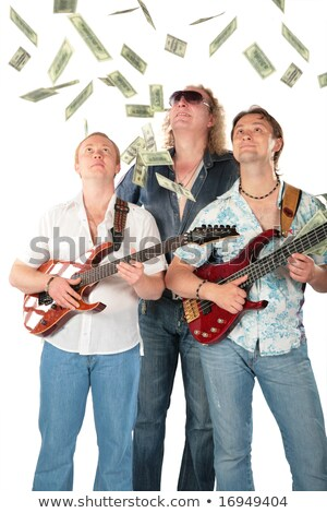 Stock photo: Three Men With Two Guitars Look On Falling Dollars