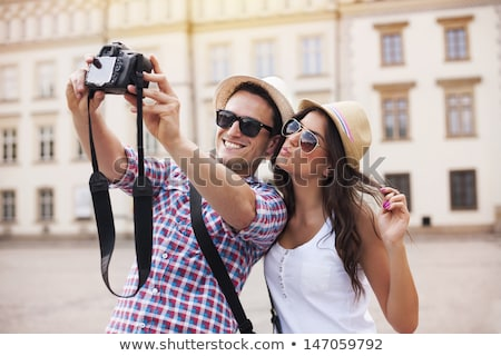 couple taking photos outdoors stock photo © photography33