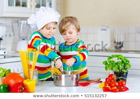 Blonde fashion funny on kitchen with pasta and Stock photo © lunamarina