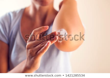 Moisturizing cream on elbow Stock photo © phakimata