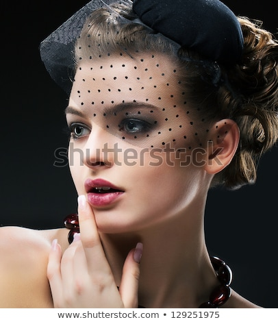 Sophisticated woman with hat Stock photo © photography33