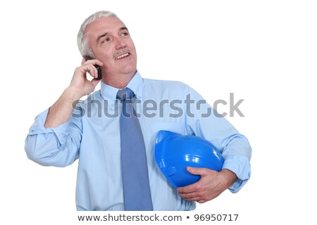 Grey-haired architect making call Stock photo © photography33