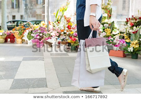 Shopper Walking With Colourful Carrier Bags Stock photo © stryjek