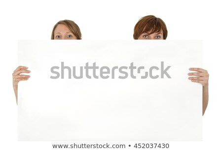 Female business promoter holding white blank banner ad Stock photo © stockyimages