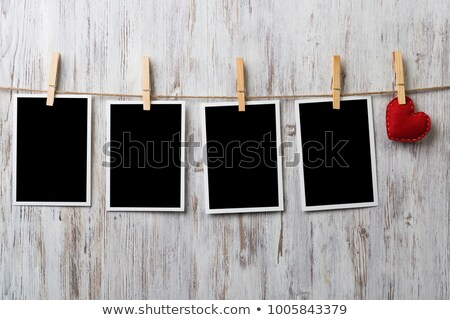 Stock photo: Photo frames and heart on rope