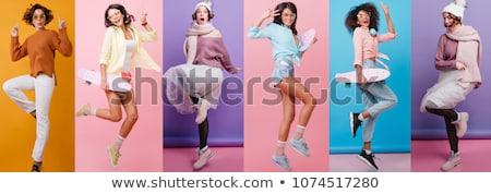 Сток-фото: женщину · танцовщицы · улыбаясь · прыжки · вид · сбоку