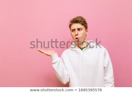 Stock photo: seated man pointing to his side