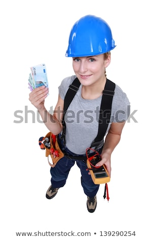 Stock photo: Female electrician holding wedge of cash