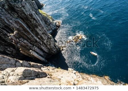 Isola pilastro piedi ripida costa Foto d'archivio © photohome