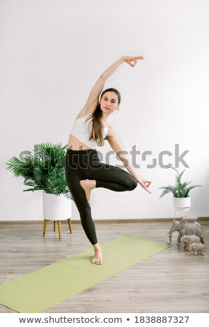 Young Women in Tree Pose stock photo © Schmedia