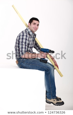 Man sat with power drill and length of wood Stock photo © photography33