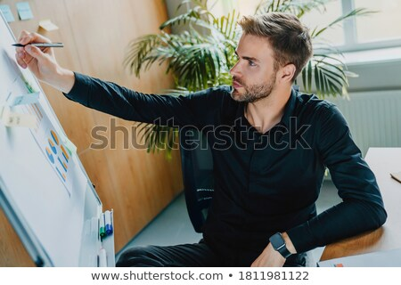 Businessman writing on a board Stock photo © photography33