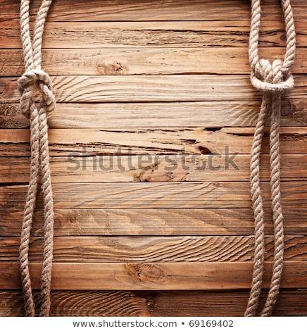 Ship ropes on wood background Stock photo © michaklootwijk