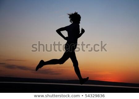 Kadın koşucu siluet gün batımı kadın kız Stok fotoğraf © premiere