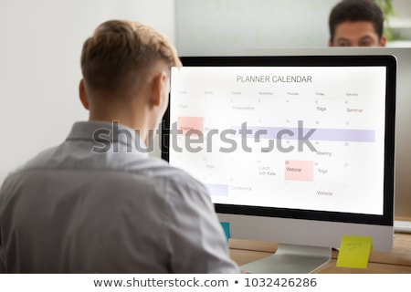 Back view of a businessman using a monitor in his office Stock photo © wavebreak_media