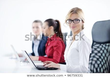 Titkárnő telefon fehér öltöny beszél női Stock fotó © wavebreak_media