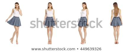 681d8a7c4d3003 Mooi meisje poseren kort rok geïsoleerd witte Stockfoto © grafvision