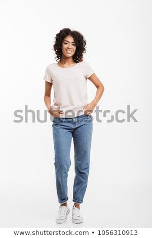 portret · permanente · vrouw · jeans · zwarte - stockfoto © phbcz