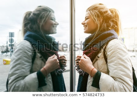 Stock photo: beautiful woman on the mirror as a twins portrait