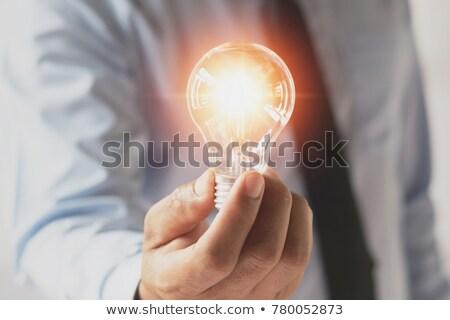 Lâmpada mão empresário negócio Foto stock © ra2studio