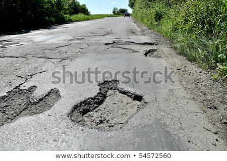 broken pavement and pothole asphalt road after winter stock photo © 5xinc