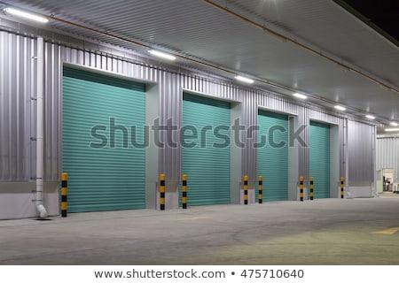Building with roller shutter door Stock photo © REDPIXEL