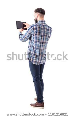 Stock photo: Corporate Man Standing and Using a Tablet Device
