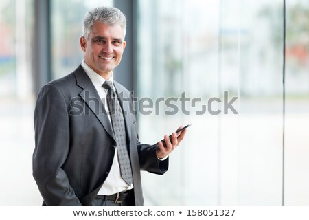 Corporate Man Standing and Using a Tablet stock photo © 805promo