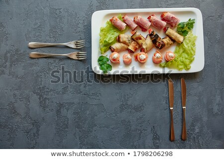 stuffing hams roll on the gray plate Stock photo © tarczas
