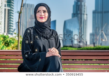 Tablet computer showing by woman sitting smiling Stock photo © Maridav