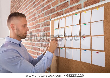 Businessman holding blank bulletin board Stock photo © stevanovicigor
