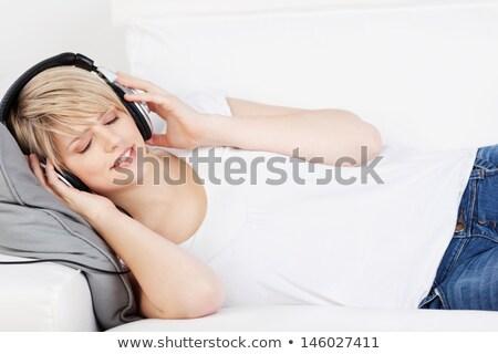 Güzel bir kadın gözleri kapalı ayakta gri kafa vücut Stok fotoğraf © dash