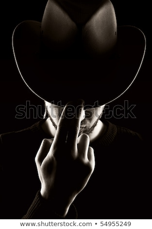 Tehlike kovboy amerikan kovboy şapkası duman puro Stok fotoğraf © anbuch