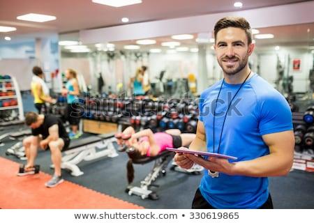 Mannelijke vrouwelijke persoonlijke trainers bar gymnasium Stockfoto © Hofmeester