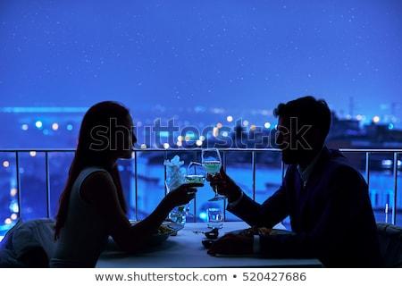 Silhouettes of an elegant romantic couple Stock photo © stryjek