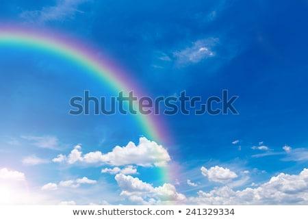 Regenboog blauwe hemel natuurlijke fenomeen wolken abstract Stockfoto © FrameAngel