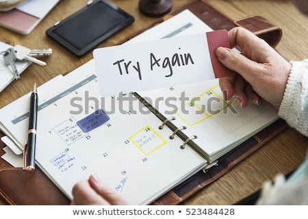 Notebook on a desk - Never give up Stock photo © Zerbor