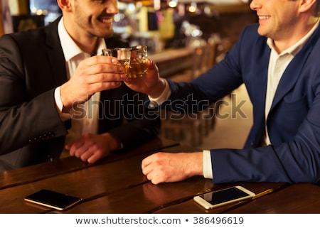 młodych · biznesmenów · mówić · bar · biznesmen · spotkanie - zdjęcia stock © nyul