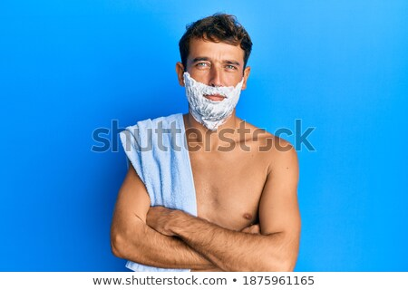 Angry handsome young man with a shaving foam Stock photo © deandrobot