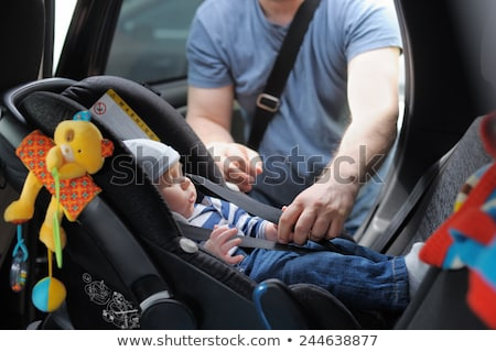 Stock photo: Baby in car seat for safety