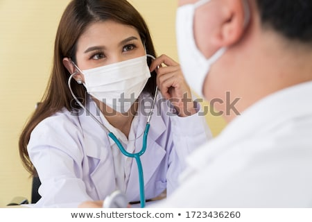 close up of doctor and woman measuring pressure stock photo © dolgachov
